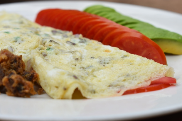tomato stuffed omelette, avocado, tomato and eggs