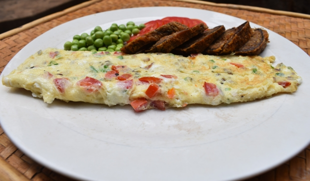 spanish omelette , peas and beef with egg